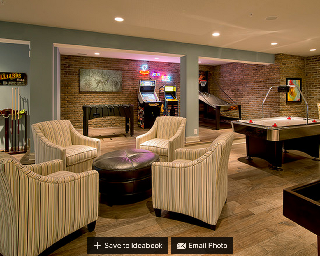 Game alcove. Brick wall in one section. Game room decor