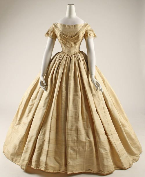 Wedding dress Date: 1859 Culture: American Medium: silk Dimensions: Length at CB: 61 1/2 in. (156.2 cm) Length at CF: 50 1/2 in. (128.3 cm) Width at Bottom: 187 1/4 in. (475.6 cm) Credit Line: Gift of Estate of Emily E. Lindsley, 1945 Accession Number: C.I.45.85.1a, b