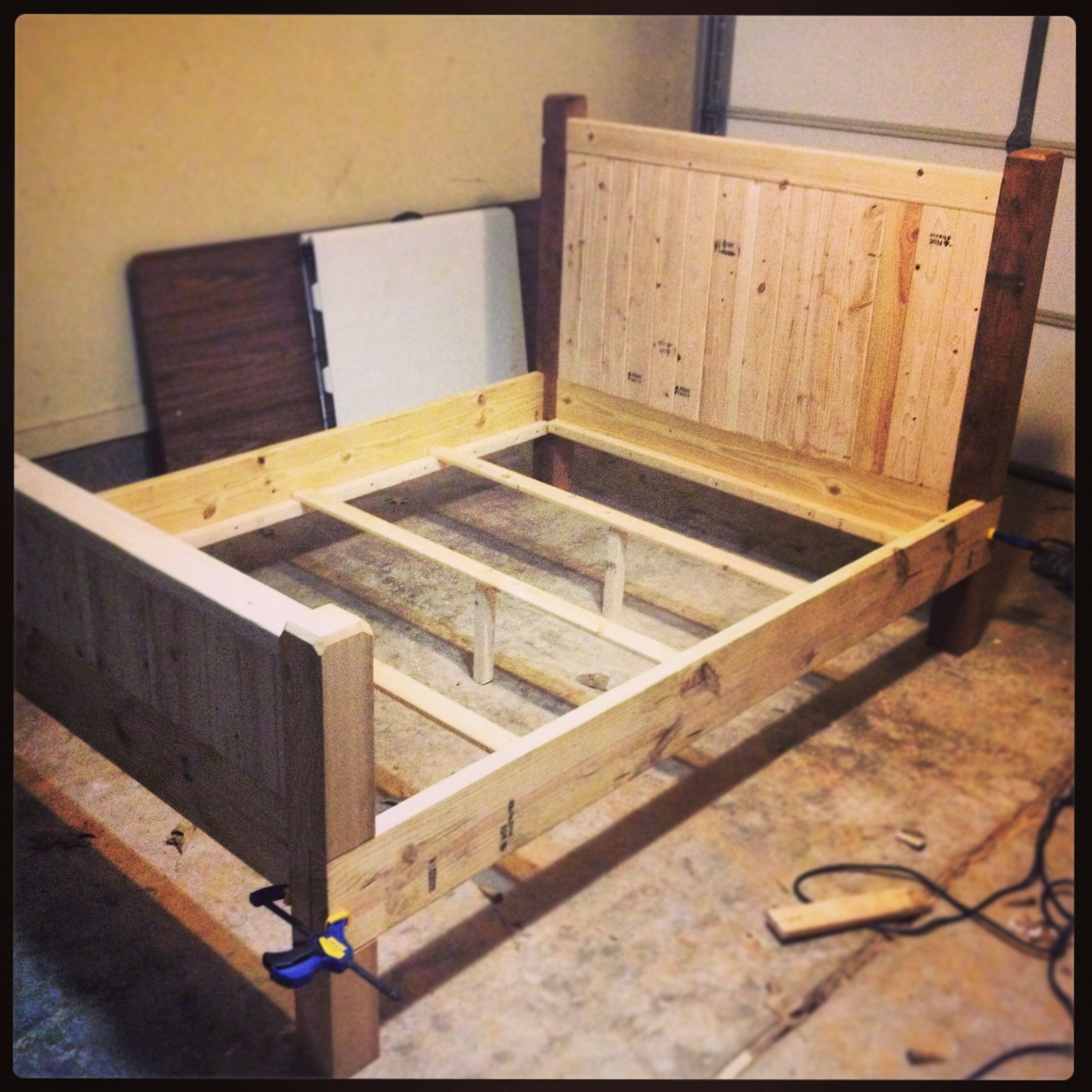 Diy full size bed frame almost finished made with 2x4s for Diy rustic bunk beds