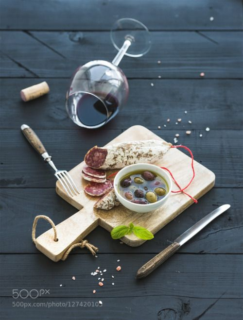 Wine appetizer set. Glass of red wine French sausage and olives on black wooden backdrop by 2enroute  IFTTT 500px selective focus alcohol antipasto appetizer background basil bistro black closeup cold
