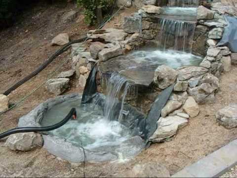 Construccion de una cascada fuente waterfall for Disenos de fuentes y cascadas