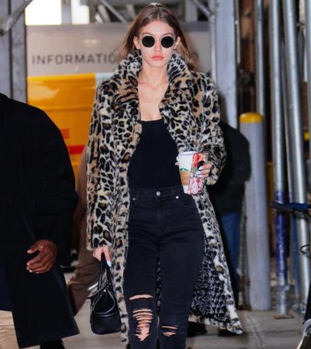 Gigi Hadid wearing Oliver Peoples The Row sunglasses, Majorelle Faux Fur  Coat, Current/