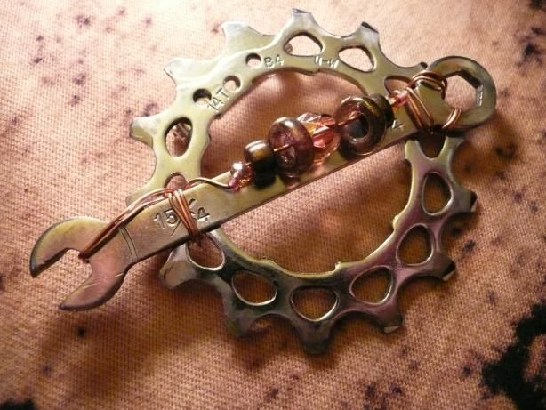 Wrench and gear brooch