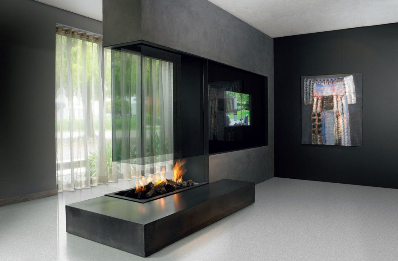 A unique and beautifully designed, modern double sided fireplace shown here  as an extension of a separating wall. Its a beautiful double sided fireplace  and ...