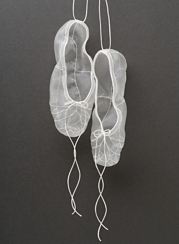 transparent white ballet slippers