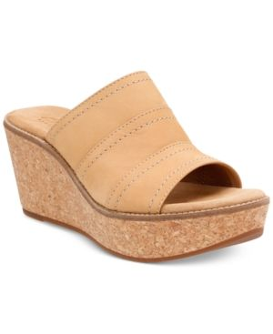 cff636001a12 Give your favorite jeans a hint of tomboy-cool with the Aisley Lily wedge  sandals from Clarks Artisan.