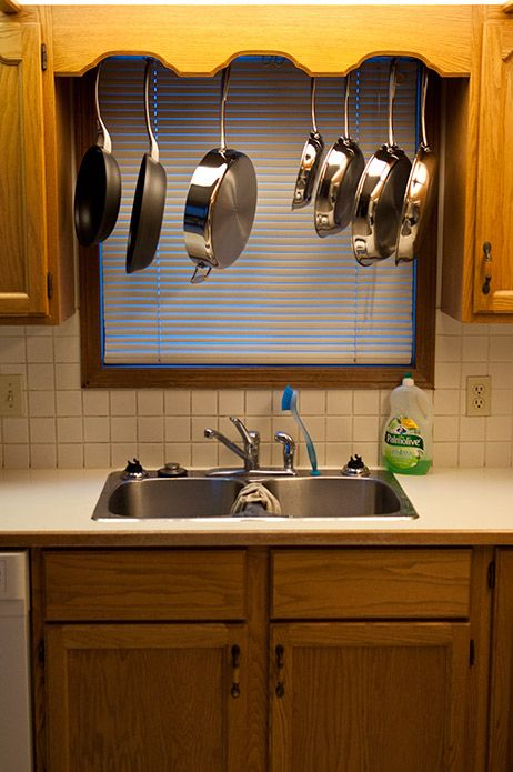 how to build a pots and pans storage rack cheaply that spans between two kitchen c diy on kitchen organization pots and pans id=16964