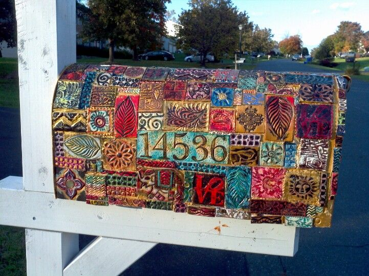 Mailbox covered in stamped, inked, painted, etc pieces ...  Funky Painted Mailboxes