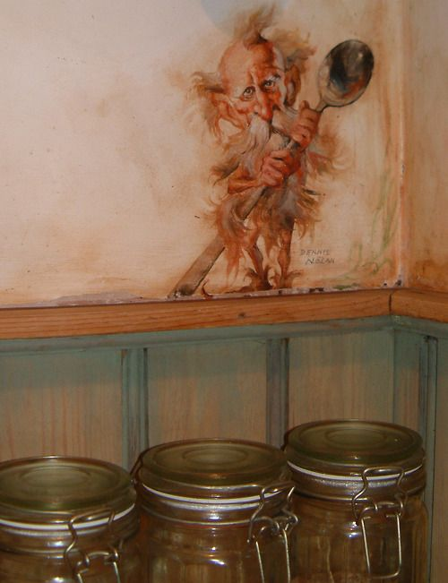 """Photo of the """"Goblin Market"""" kitchen in Weaver's Cottage.  A close-up photo of the Spoon Goblin by the American children's book illustrator Dennis Nolan."""