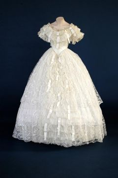 Wedding Dress  Lace, satin ribbon and silk net with skirt flounces of Limerick lace, a hand embroidered machine net.  Made in 1860