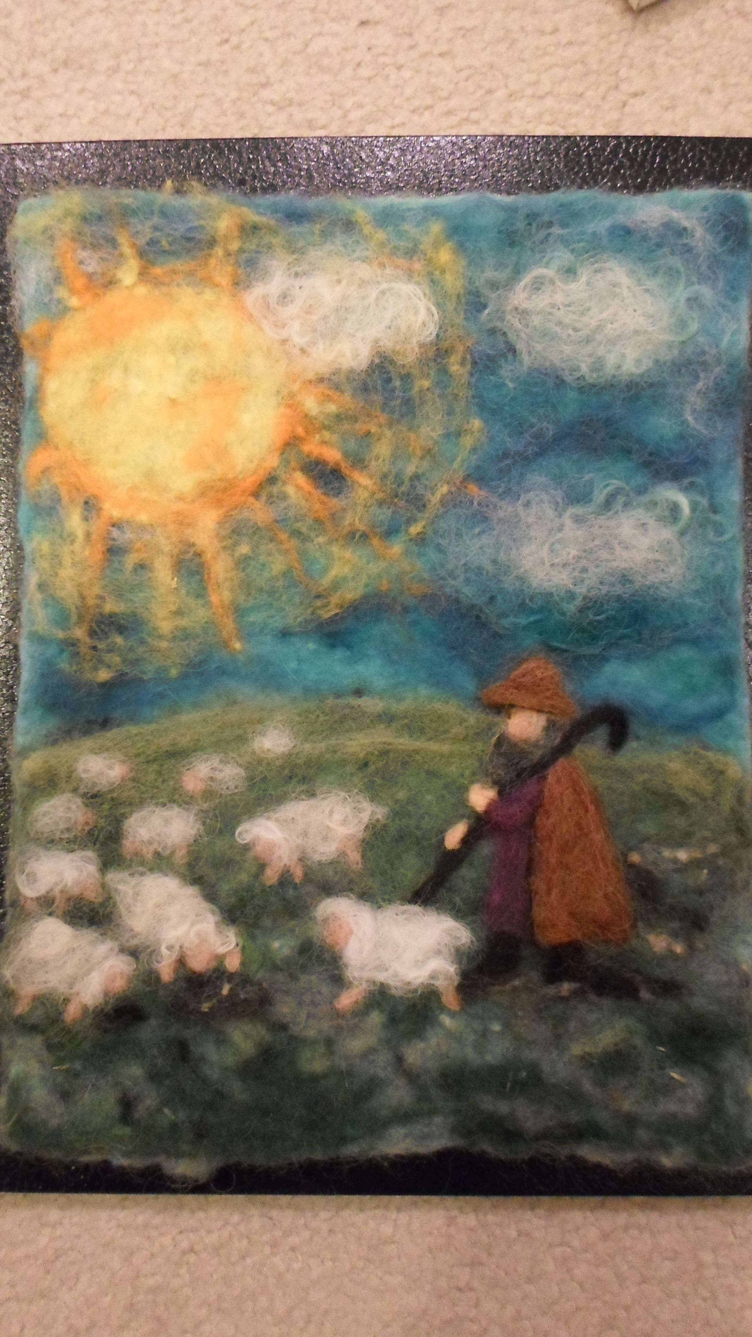 Wool Painting of a shepherd and his wooly flock.
