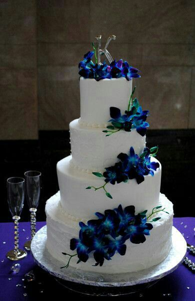 Beautiful four tier round white wedding cake with fresh purple beautiful four tier round white wedding cake with fresh purpleblueteal dendrobium orchids mightylinksfo
