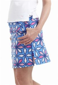ladies flat front golf skort with pink and blue geometric flowers | #golf4her #golftini
