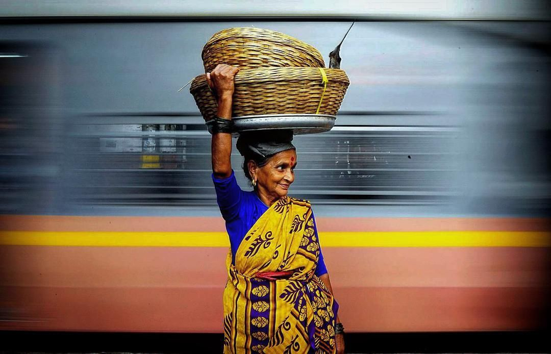 A fisher women waits for a local train to head home for her daily business in Mumbai, this one of my award winning picture on mumbaimeri jaan photo contest  #dailylife #fisherwomen #photojournalism #train #business #everdaymumbai #mumbaimerijaan #streetphotographyindia #gettyimages #gettyimagesinstagramgrant #smile #photooftheday #dailylife