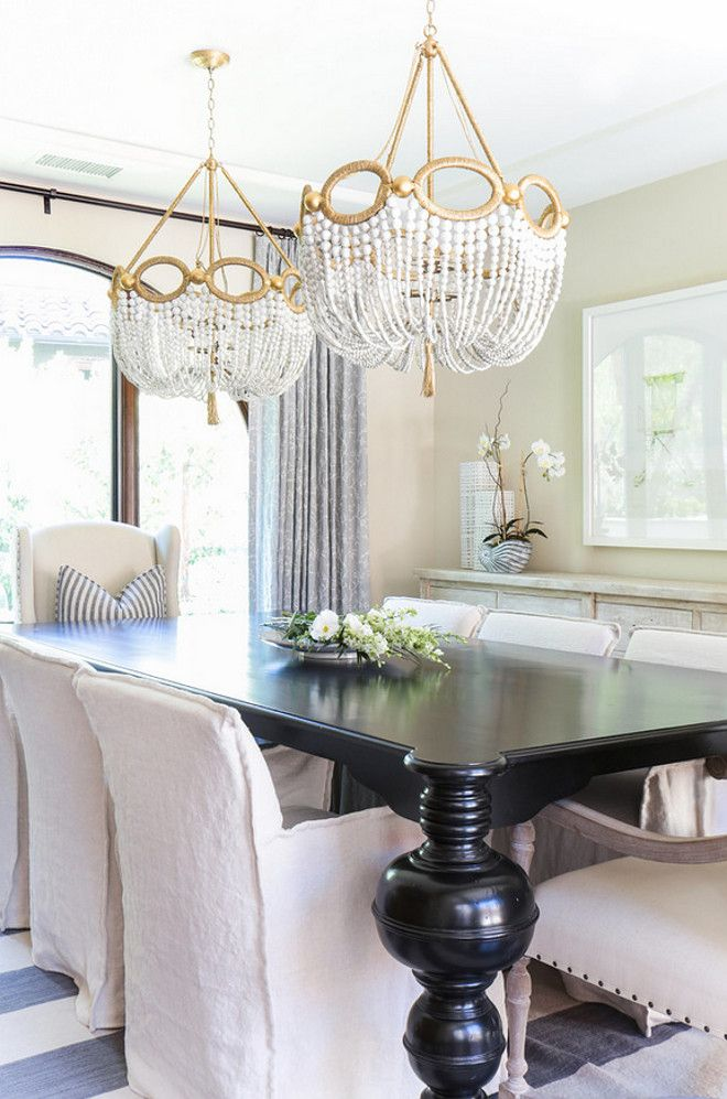 Two chandeliers above table Dining room and