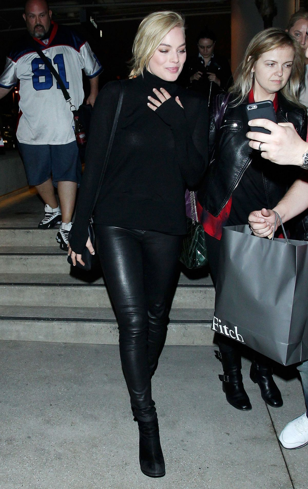 0708a64276bb1b Margot Robbie Style - Margot wore black sweater, black leather leggings by  Alice + Olivia, black ankle boots and black leather Fendi bag #womenswear  ...