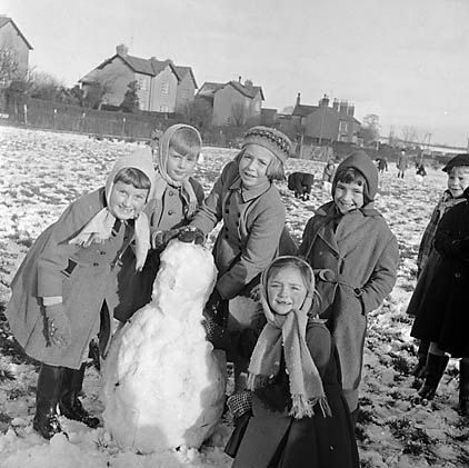 Vintage Winter: What fun. Children at the Oswestry Infant school enjoy a snow day. Oswestry, Shropshire, England. Circa 1956. Photo Credit: Geoff Charles, The National Library of Wales