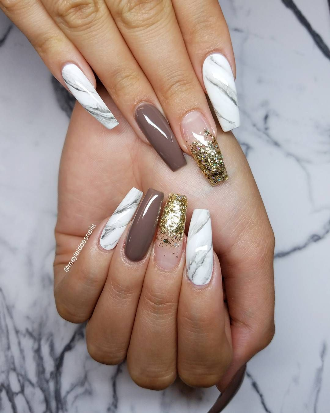 Marble, gold nails and all that jazz