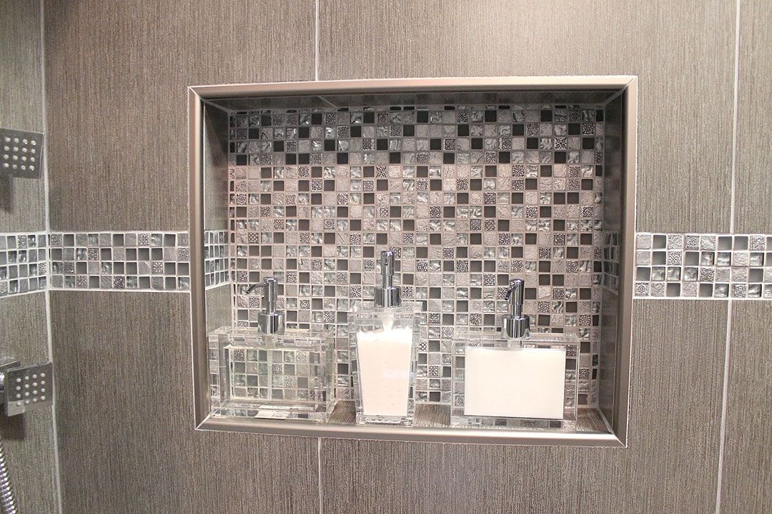 Double shower niche witn metal trim and decorative glass accent tile our new nest pinterest - Decorative bathroom tiles ...