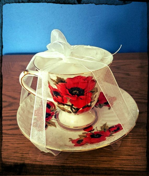 Check out this item in my Etsy shop https://www.etsy.com/uk/listing/243478547/vintage-style-fine-china-poppy-teacup