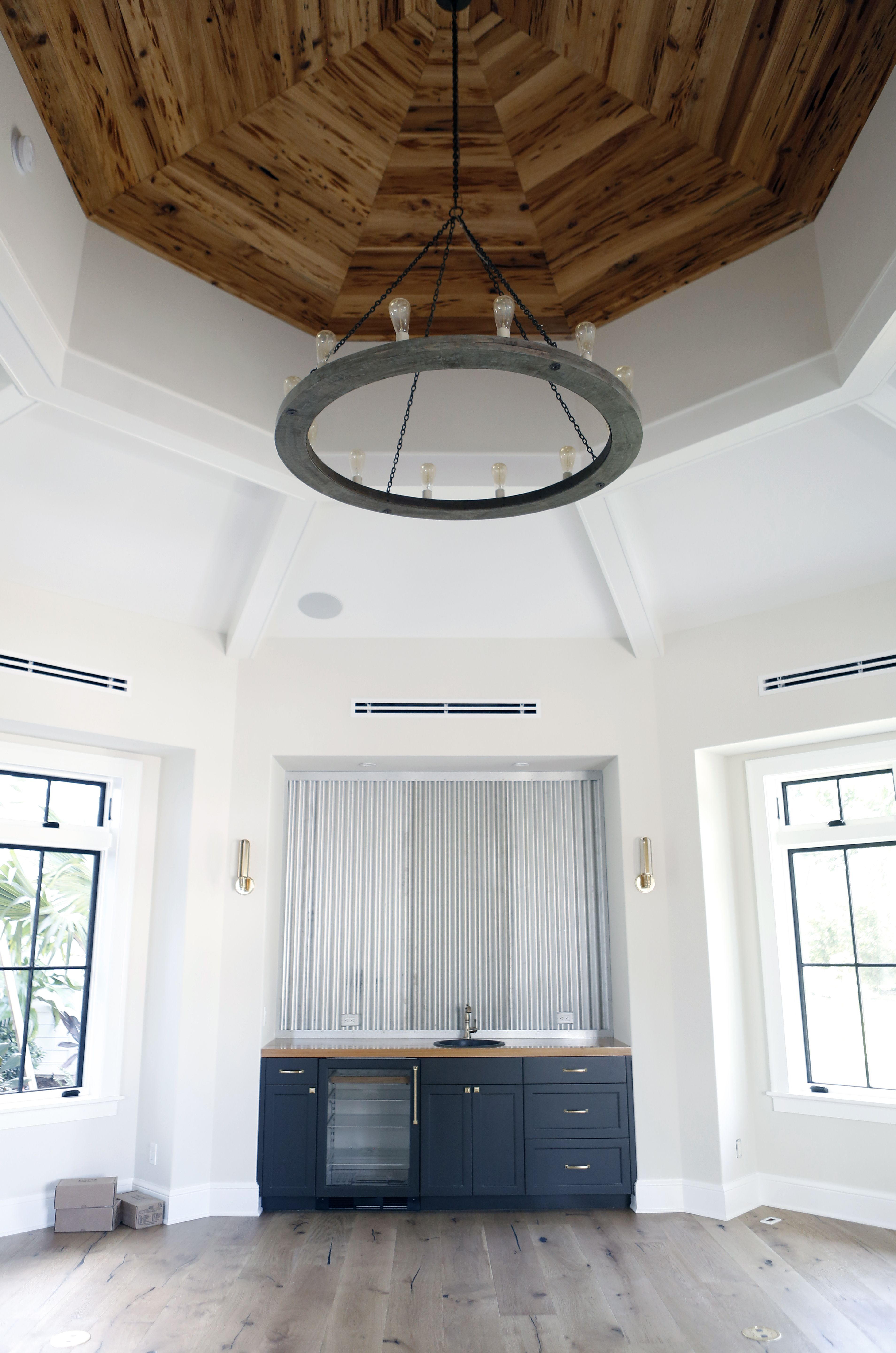 Love the pecky cypress ceiling in this farmhouse home theater. Farmy ...