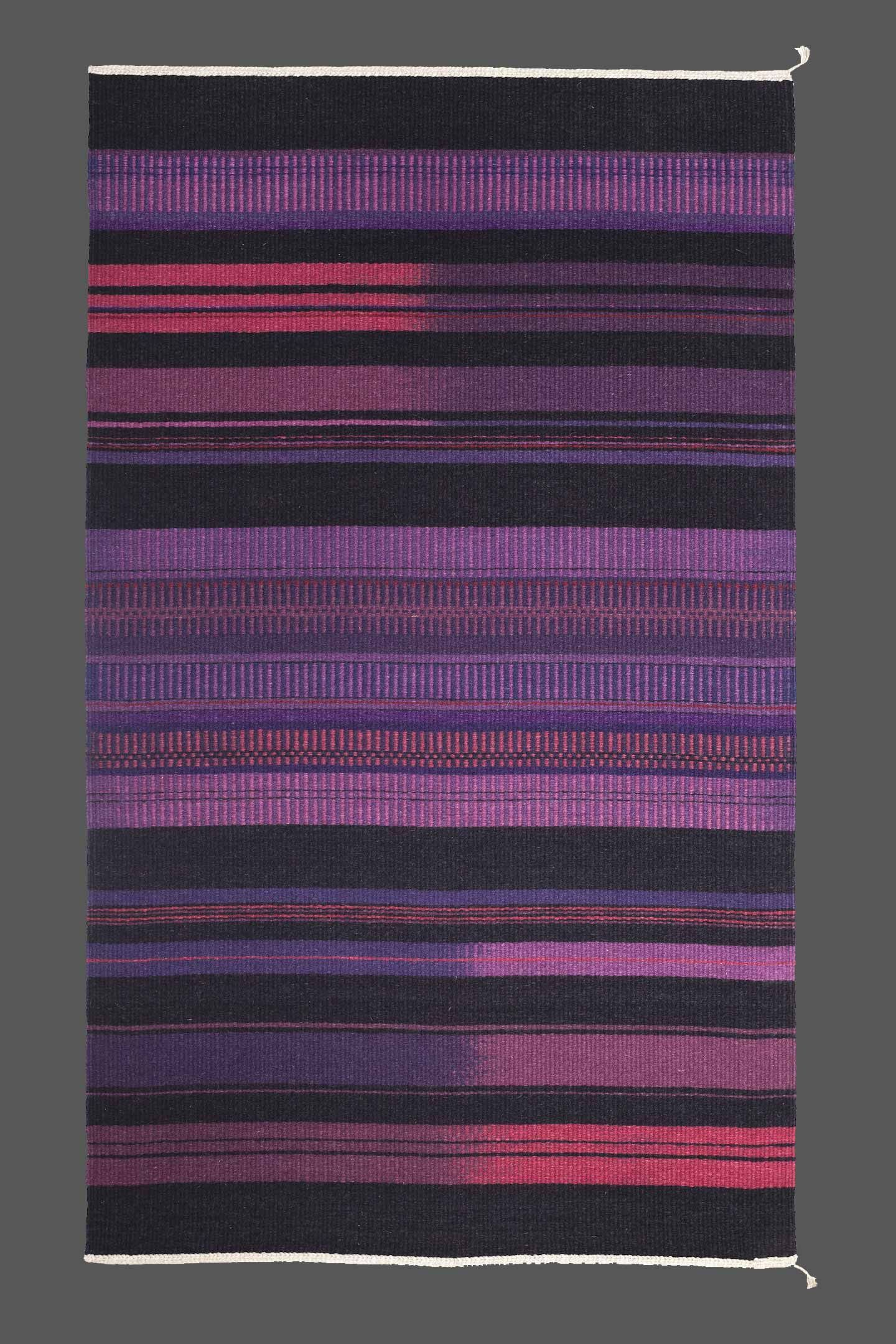 Handwoven ikat dyed wool rug with linen warp by marjorie