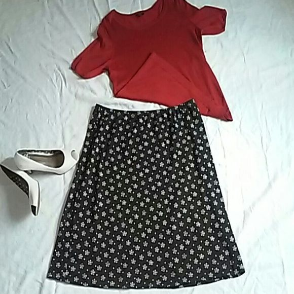 Mid Length Skirt This is a great skirt for spring & summer weather! Very light material, navy blue with white dots and flowers. It goes just below the knee, almost mid calf. Dress it up or down and either way it'll look great! The material is soft and comfy. Its a 1X but has lots of stretch to it. Length: 22 1/2in. Waist: 17 3/4in. Lands' End Skirts Midi