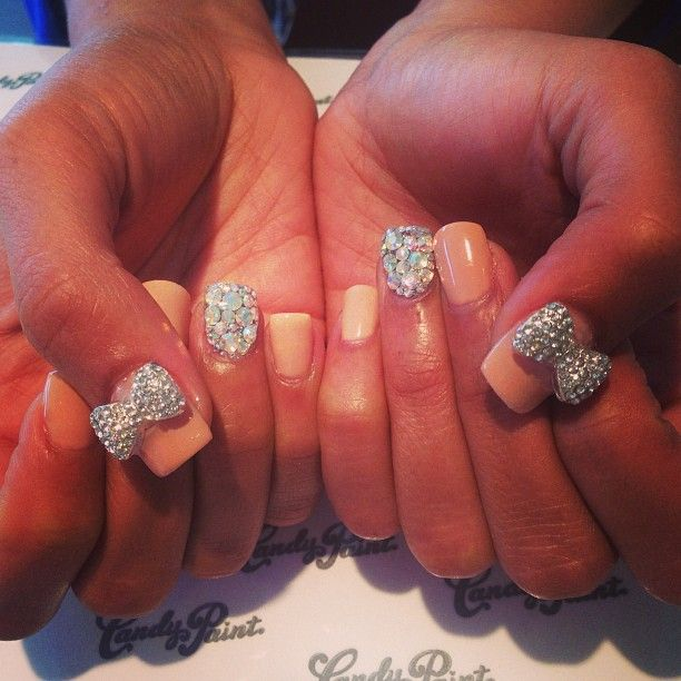 CandypaintLA Nails- Nude and Swarovski bow charms.