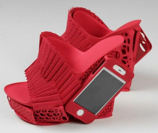 These funky 3D-printed shoes have a holder for your phone! Then u can step on ur phone when it falls out! What a great idea! No, they must have been drunk