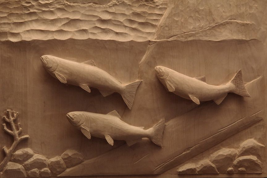 An example of constructed high relief the fish are carved