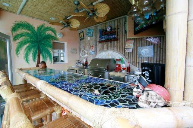 the tiki bar was custom designed with a beautiful mosaic