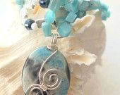Silver wire wrapped blue and black agate pendant/necklace. http://www.etsy.com/shop/designedbydonnad