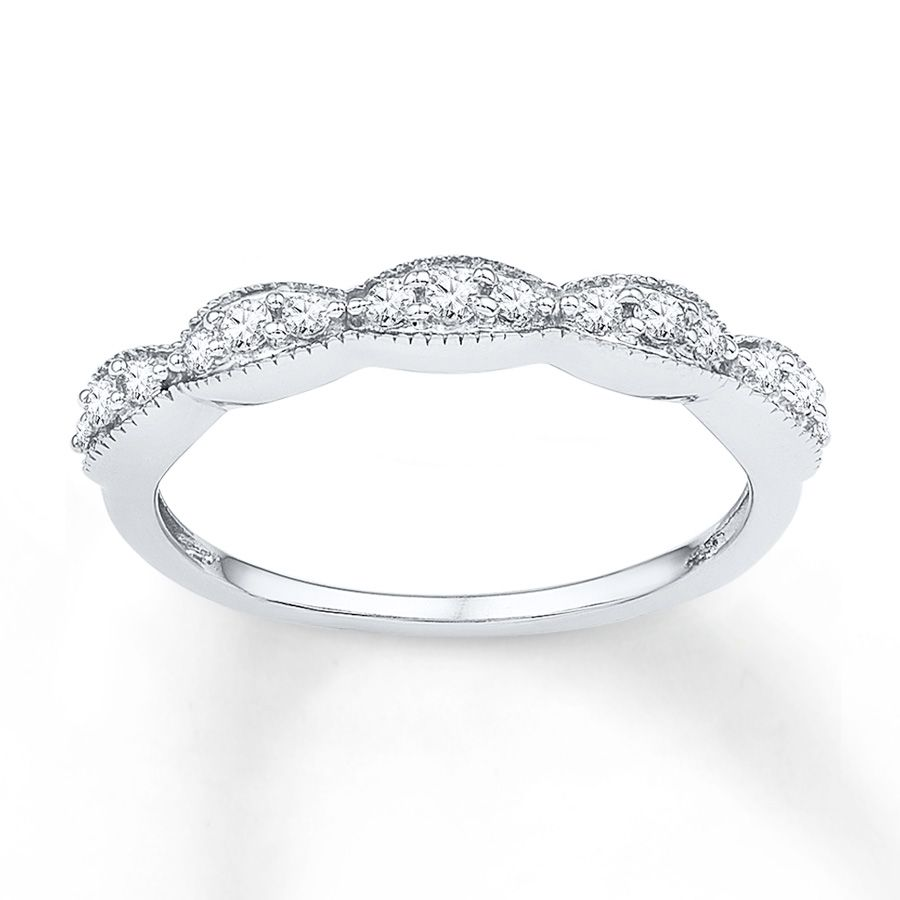 Shimmering Round Diamonds Dance Along A 10K White Gold Band With