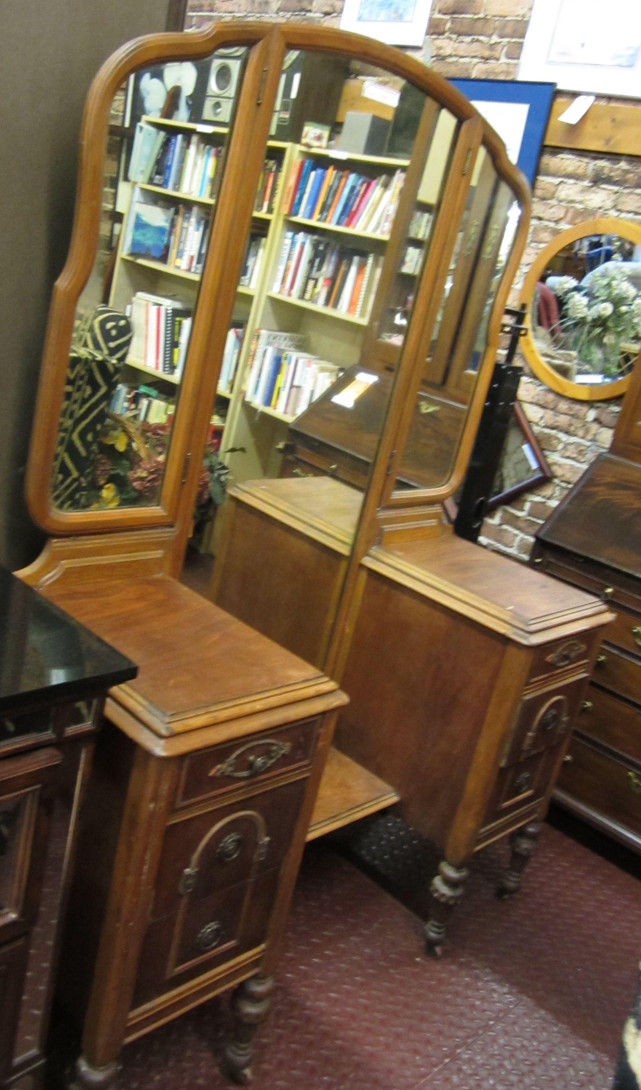 Antique wood vanity with adjustable mirrors