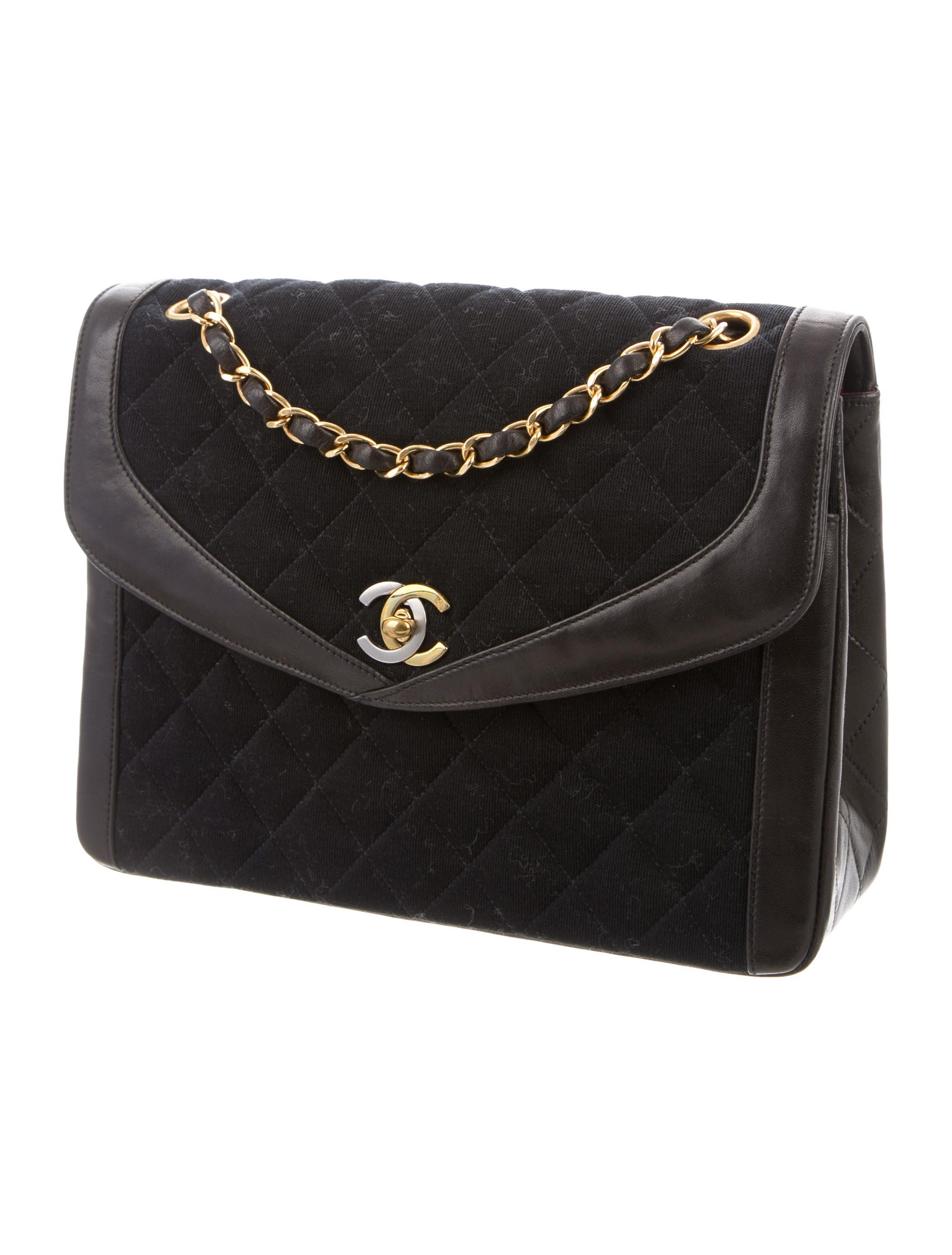 c1bd636e9d13 Black quilted woven Chanel Vintage Jersey Flap Bag with gold-tone and  silver-tone hardware