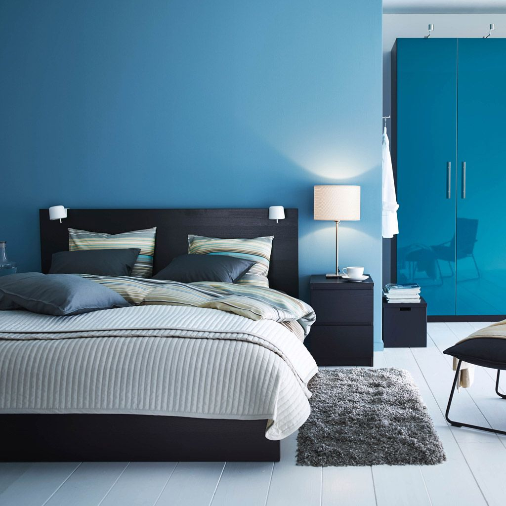 a modern blue and black bedroom with malm bed in black and pax