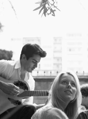 © Deborah Jaffe, couple hanging out, guy playing guitar, Los Angeles