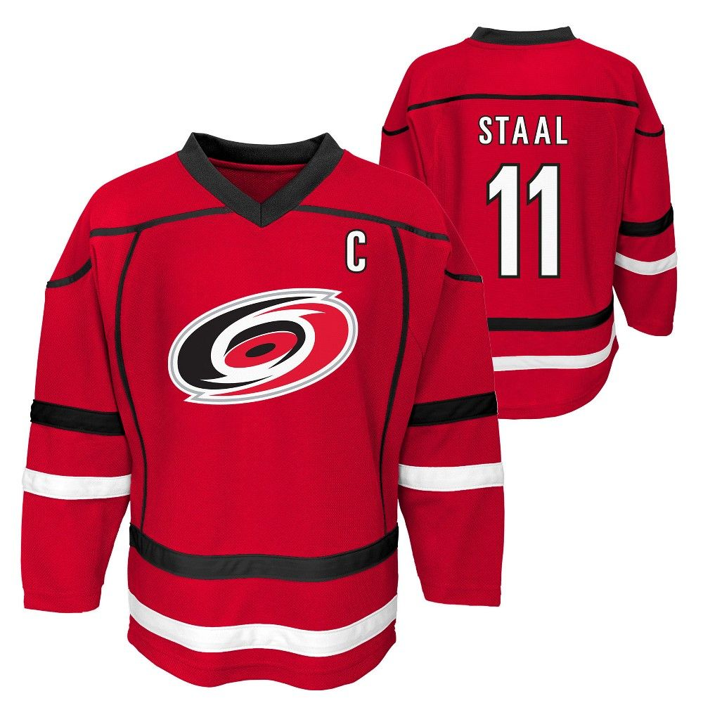 af012f094 Cheer on the Carolina Hurricanes in style with this official NHL Boys  jersey. This sports apparel top makes your allegiance unmistakable using  team color ...