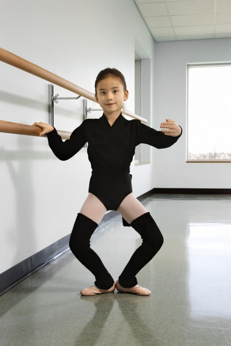 Ballerina doing Plie