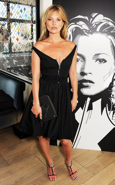 Kate Moss at the Kate Moss for Carphone Warehouse preview in London on July 18, 2013 (Prada dress, Kate Moss for Longchamp bag, Christian Louboutin shoes)