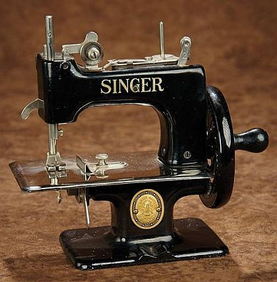 Child's Metal Toy Sewing Machine by Singer.