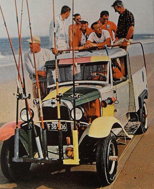 1950s  Men On Beach Fishing Poles