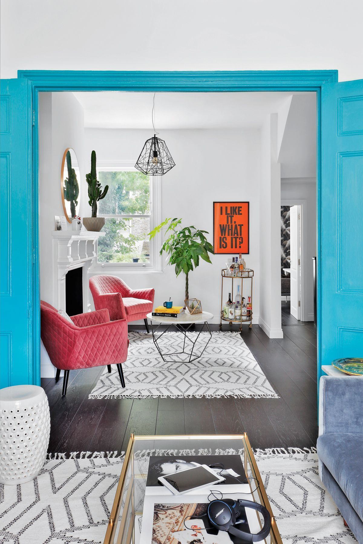 By Adding Bursts Of Colour Such As These Pink Chairs Blue Doors And Orange Artwork You Can Add Colourful Living Room Living Room Turquoise Pink Living Room #turquoise #and #pink #living #room