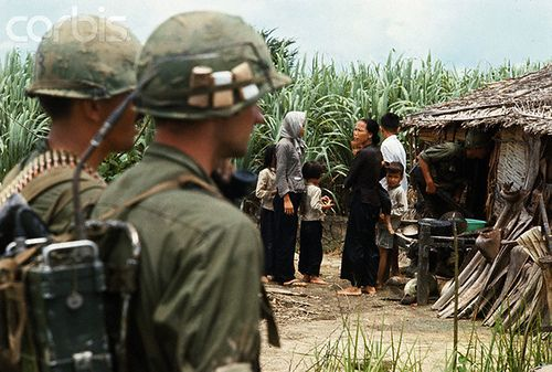 ca. 1969, Saigon, South Vietnam --- Saigon, South Vietnam: Troops of the Ninth Division pick up Viet Cong suspects for questioning in the delta area south of Saigon in the summer of 1969.