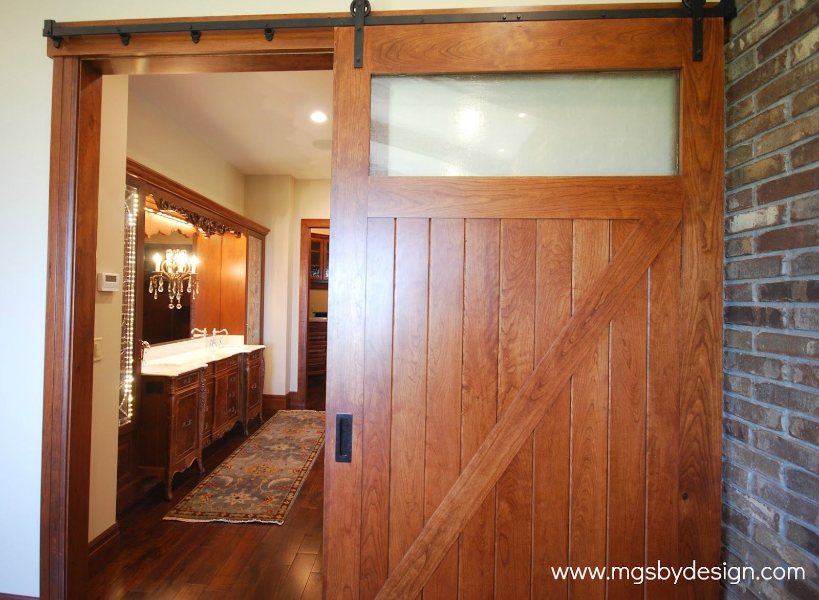 barn door from master bedroom leading into master bath. Black Bedroom Furniture Sets. Home Design Ideas