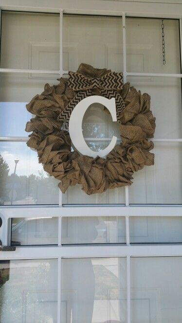 Shotcut burlap wreath  Used: 6 foot burlap panel already assembled, floral wire, 4 inch chevron burlap spool, 16 inch wire wreath, glue gun, white acrylic paint, and unfinished letter C. All purchased from Hobby Lobby.
