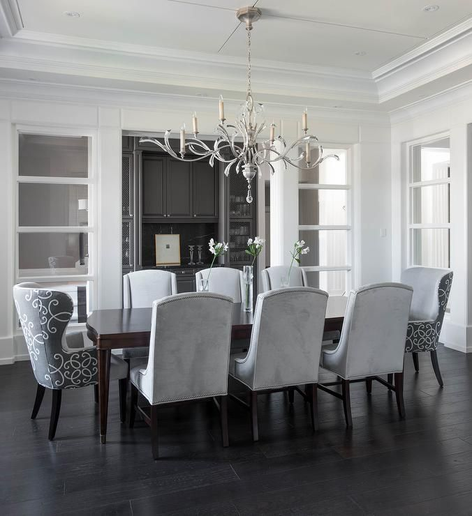Chic Dining Room Features A Tray Ceiling Accented With A Satin Nickel And Glass Chandelier