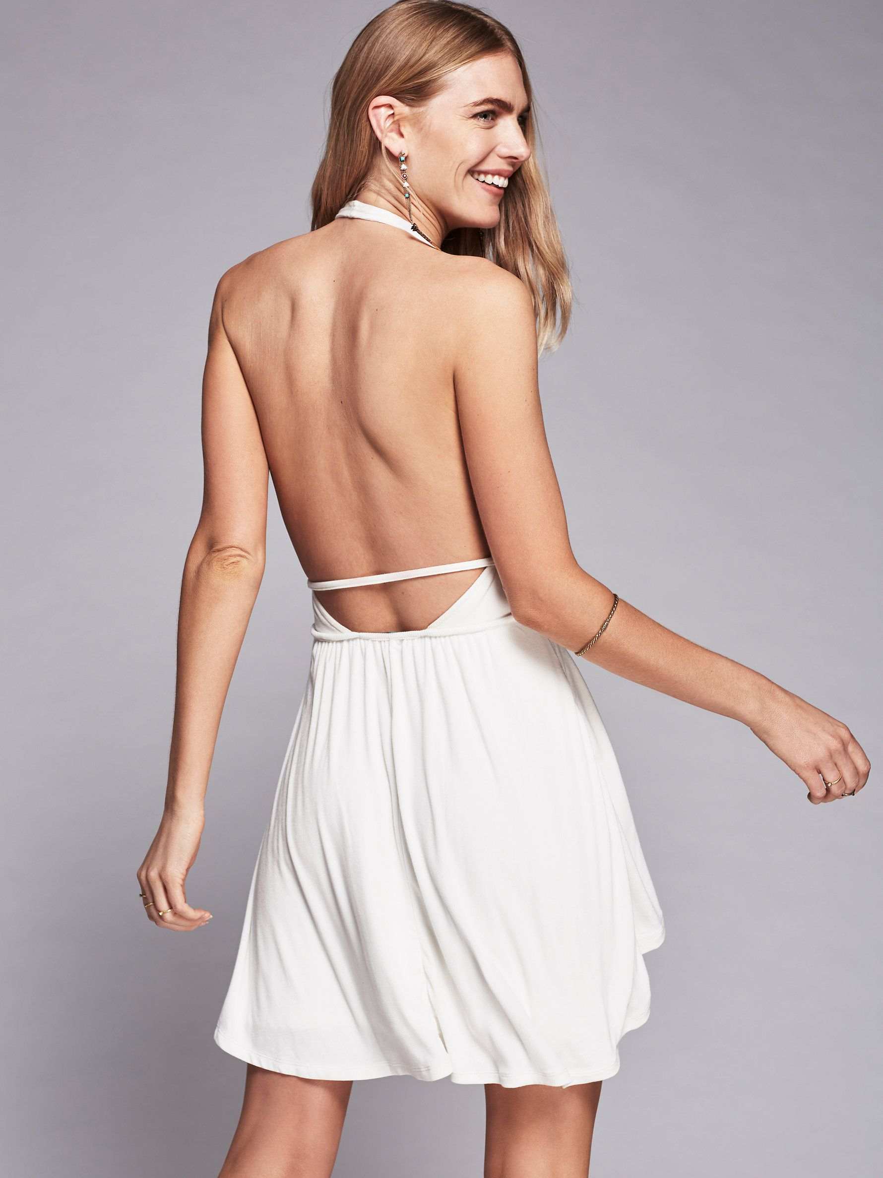 Neptune Flare Mini Dress | In our easy Beach jersey ribbed fabric this easy mini dress features a plunging V-neckline, halter neck and swingy skirt. Low back and an overlay along the skirt.
