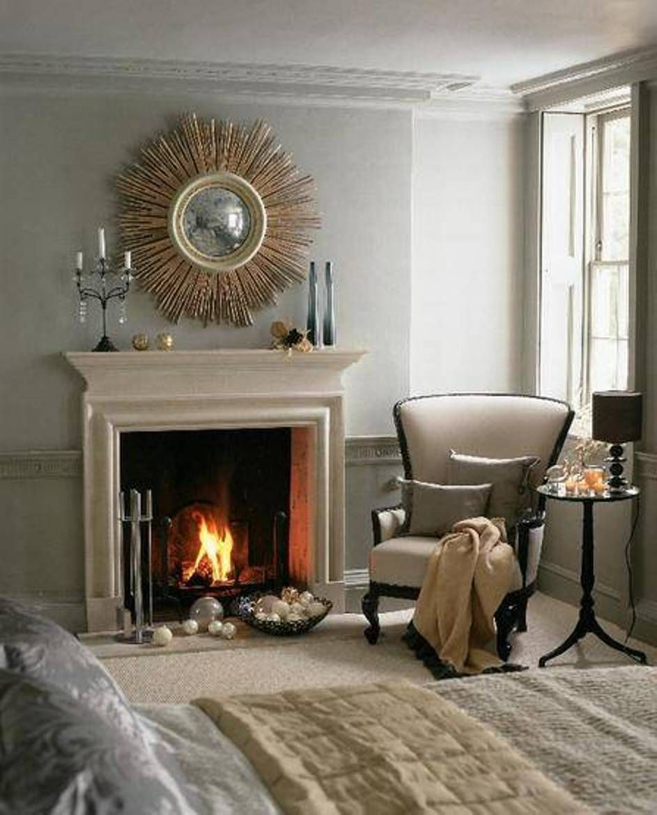 sunburst mirror over fireplace mantel | bedroom | sunburst mirrors