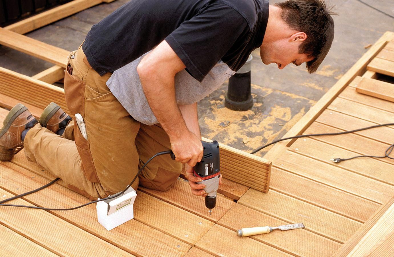 Long On Life Span And Short On Fuss These Man Made Boards Never Splinter Rot Or Need Staining The Toh Team Expla Building A Deck Deck Design Plans Diy Deck